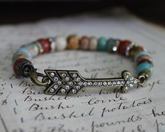 cinnamon creek dry goods......Arrow Bracelet.... Beautiful jasper beads with rhinestone & brass touches. .... 25.00
