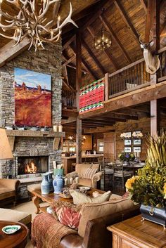 This is my dream home!!!! High ceilings, big fireplace, big windows,and log cabin!!!!!!!! I want it now!!!