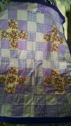 Purple quilt with plus sign flowers. Lap quilt.