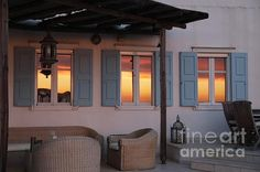 Cycladic Architecture with the Setting Sun Reflexions on the Windows.