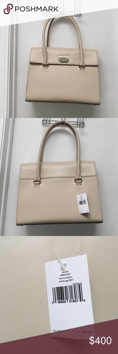 Kate Spade handbag/purse NWT Kate Spade handbag/purse NWT cream color. 13.5in along the bottom and 10in top to bottom. This is a super classy bag. Message me if you have any questions. Some room for negotiation  kate spade Bags Shoulder Bags