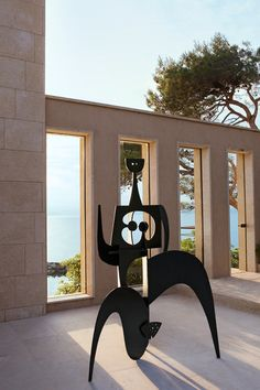 Saint-Tropez villa of gallerist couple Yves and Victor Gastou featured in AD France: Painted steel sculpture by Philippe Hiquily, 2004. / AD France