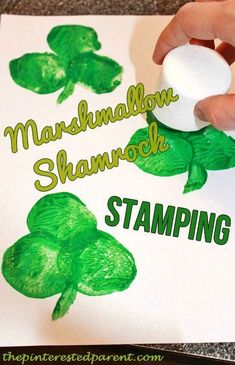Marshmallow paint stamped shamrocks for St. Patrick's Day. An easy kid's arts and craft projects for preschoolers and toddlers this spring! #stpatricksday #kidsspringart