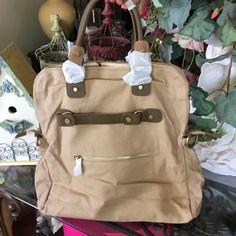 "LARGE CANVAS BAG INTERIOR HAS TWO ZIPPER POCKETS ON ONE SIDE-TWO OPEN POCKETS ON THE OTHER SIDE-EXTERIOR-ONE SIDE HAS A ZIPPER POCKET-IS ABOUT 15""IN LENGTH-ABOUT 15""WIDE-THE SHORT BAG STRAPS ARE ABOUT  5"" HIGH Bags Hobos"