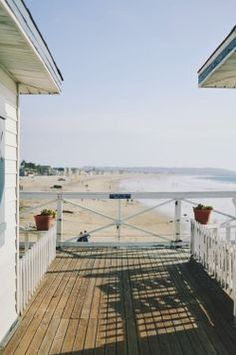 beach shadows + deck + picket fence