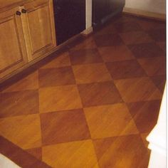 Patterned plywood floor done with stain instead of paint. I like!