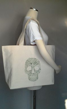 Skull with flowers. Professionally embroidered on your choice of tote bag and any color thread. Please view tote choices in my shop section: Choose Your Own Bag. Tote details(pictured above) also available in black, red, navy, and royal Natural Jumbo cotton canvas tote. Choice No.1. Any design in my shop can be embroidered on this bag. Jumbo Cotton Tote: Size: 20w x 14.5h x 4.5d 100% cotton canvas 12-oz. extra-long web handles (color: natural) reinforced at stress points CUSTOM ORDERS ...