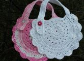 This pattern is from Ravelry and is called Round Baby Bib. It's free and absolutely adorable.