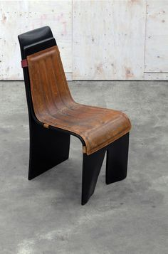 Laquered wood chair with leather padden cushion.