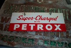 """In 1954 Texaco introduced Petrox, a detergent additive to Sky Chief gasoline. These 8""""X12"""" signs were added to the bottom of the Sky Chief Pump signs until the new Sky Chief with Petrox pump signs were available.   Sweet Picture!  Have a look at at all these great signs I found for your mancave all starting at a penny!  Just Click the photo above:  http://stores.ebay.com/clockworkalpha/"""