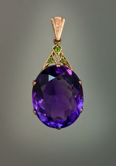 An Art Deco Siberian Amethyst, Demantoid Garnet and Rose Gold Pendant Necklace. The pendant features an oval cut large Siberian amethyst with an Purple Jewelry, Amethyst Jewelry, Gems Jewelry, Art Deco Jewelry, Gemstone Jewelry, Jewelry Accessories, Cheap Jewelry, Amethyst Necklace, Pendant Necklace