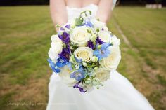 Beautiful blue and purple wedding bouquet at Laughton Barns.  Creative wedding photography in Sussex by http://www.dennisonstudios.com