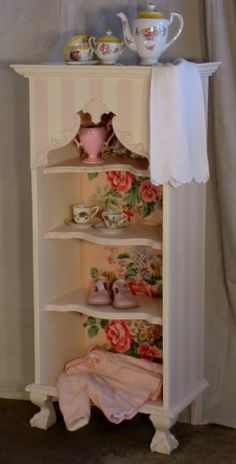shabby cabinet -- looks like it could be made from a dresser by removing drawers and replacing with shelves