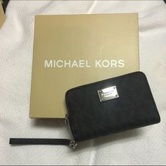 Authentic Michael Kors Iphone 5  Wristlet NWT Selling an authentic Michael Kors patterned Wristlet. Colors are gray and black. Fits iPhone 5 and below. Does not fit the 6. Perfect for a night out! No scratches on the hardware. Hardware is silver. Does not include wrist strap. I don't trade Michael Kors Bags Clutches & Wristlets