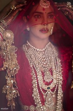 Priyanka Chopra Looking Ethereal On Her Wedding Day. The Red Lehenga Is By Sabyasachi And The Wedding Took Place At Jodhpur's Umaid Bhawan Palac. Indian Bridal Outfits, Indian Bridal Fashion, Indian Bridal Makeup, Indian Bridal Lehenga, Pakistani Bridal, Bridal Beauty, Sabyasachi Lehenga Cost, Red Lehenga, Lehenga Choli