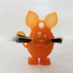 Available is an orange light green Rat Fink charm with ring hole. Cracker Jacks, Rat Fink, Charm Rings, Big Daddy, Light Orange, Gumball, Mustache, Rats, Charmed