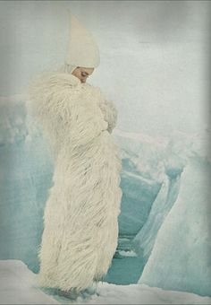 White ostrich feather coat by Georges Kaplan, Hat by Halston, photo taken at Resolute Bay by John Cowan