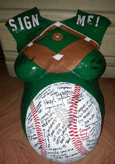 Love this idea of the baseball theme with friends writing words on the baseball part of the belly cast!