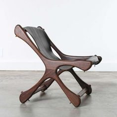 Don Shoemaker; Granadilla Wood and Leather 'Sloucher' Chair, 1960s.
