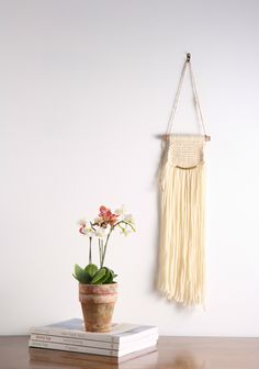 """Off White / Cream Modern Macrame Wall Hanging Tapestry on Wood Bar w/ Brass Accent.  The """"Vintage Modern"""" Macrame Wall Hanging Collection is inspired by my love for mid century modern and contemporary design. There is nothing wrong with mixing the old with the new! The pieces in this collection are so versatile that they would be a great accent to any space or decor style.  Size: Large Materials: 100% wool fibers + brass + wood   Dimensions: 6""""w x 26""""h Total height with string: 35""""h"""