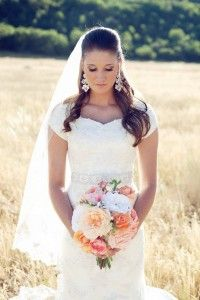 Beaded lace modest mermaid wedding gown with sleeves, sweetheart neckline, and jewel/beaded belt from Sweetheart Bridal