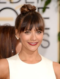 At the Golden Globes, Rashida Jones topped the beauty trends with a braided bun, piecey bangs, and a very berry lip.