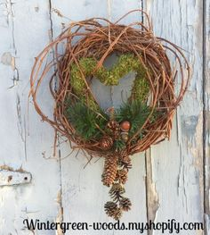 This unique wreath can be displayed all year long. I've made the grapevine wreath from the wild Grapevine that I've harvest in the woods behind my home. I also collected the moss that I made the heart