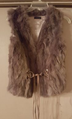 Super cute and stylish women's rabbit fur vest from Love Token. Color: Taupe : Size: Small    It features:     - Hook and eye closure  - V-neck  - Sleeveless  - Allover genuine rabbit fur construction  - Self tie leather belt harness  - Lined     Fiber Content:Body fur: Genuine rabbit fur (origin: China)  Lining: 100% polyester  Belt trim: 100% pig leather    | eBay!
