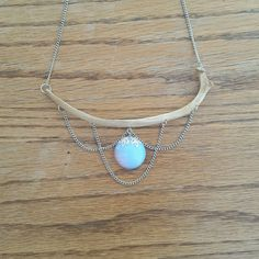 This stunning necklace features a large circular opalite stone hanging from a large, nature-cleaned rib bone. It has beautiful draped chain accents and hangs from a 20 inch soldered rhodium curb chain. Chain length can be adjusted. Jewelry Crafts, Handmade Jewelry, Unique Jewelry, Skull Crafts, Rib Bones, Bone Crafts, Bone Jewelry, Animal Bones, Luxury Jewelry