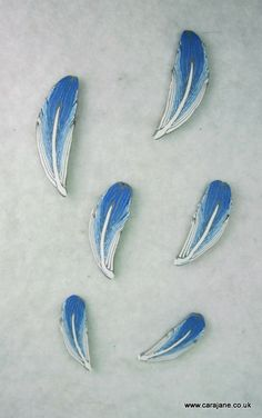 https://flic.kr/p/bjGyYS | TAD 22 - Feathers | I made a little feather cane with a scrap of blue left over from yesterdays necklace using the Donna Kato tutorial on Polymer Clay Central. Now I've made one I will know how to control the colours better next time (more clay would help!)  Not quite sure what to do with them - didn't put any holes in - will drill some when I have a plan!  Blog  | Twitter | Facebook