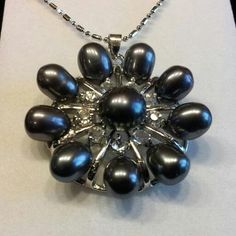 Black freshwater and Akoya pearl pendant necklace with CZ accents.