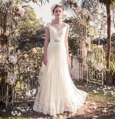Snow by Annasul Y - Hong Kong - A romantic A-line wedding dress with cap sleeves & lace embroidery details.