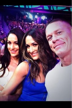This is a picture of John Cena, Nikki and Brie Bella