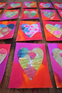 Paint newspaper with watercolor then cut out hearts. Simple and recycled Valentine's for the whole class!