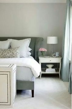 Relaxing bedroom setting - love the off whites and grey tones