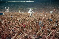Crowd cheers during Live Aid famine relief concert at Wembley Stadium in London.