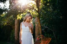 Real bride Samantha in stunning Ti Adora Bridal gown! The back has thin straps and low cut!