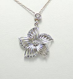 Sterling silver cubic zirconia charm necklace by KurtArtJewelry
