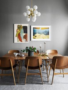 a colorful pair holding their own in a mid-century dining room.