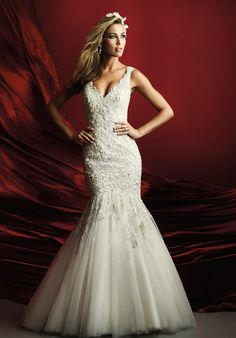 This figure-slimming gown is covered in dazzling Swarovski crystals and finished with a mermaid hemline   Allure   https://www.theknot.com/fashion/c369-allure-couture-wedding-dress