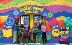 Create excitement for the Book Fair with a colorful entrance. Use vibrate plastic table covers to wrap your walls in a swirly, 60's pattern.