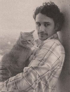 My two favorite things : - a brown-haired and bearded man - with a cat.