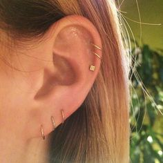 """""""I did these top three piercings. I love a double helix with yellow-gold rings, especially if you have blonde hair; it just looks great. This entire ear is a perfect combination — it's clean, classic, and timeless. You can wear this for years, and it's never going to go out of style. It's an everyday look."""" #refinery29 http://www.refinery29.com/multiple-ear-piercing-ideas#slide-3"""