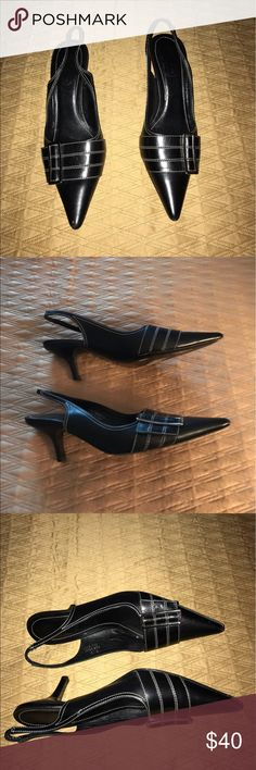 Black Coach Shoes with metal buckle Black sling back shoes with metal buckle in the front. A little spot on the toe that is easy to cover up with black polish. White threading details stand out. Really stylish shoes. Coach Shoes Heels