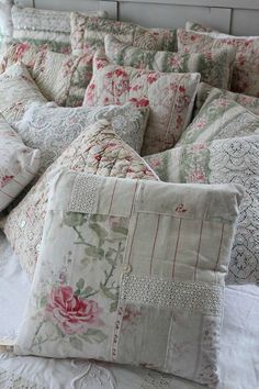 What a lovely collection of Pillow Shams~Love the lace scattered around with the flower print and soft greens~❥