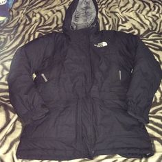 North Face Goose Down Coat❄️ This coat is the warmest thing on the planet! Goose down interior keeps cold completely out and the putter shell blocks wind. 6 outer pockets with zippers so you won't have to worry about losing keys, your phone or wallet. Also a 7th pocket on the upper inside AND outside on the chest. 8 pockets total! Also has Velcro closures over the zipper, Velcro adjustable tabs to close  the wrists so that snow/cold doesn't get in. Pully tabs on the hood as well. Extremely…