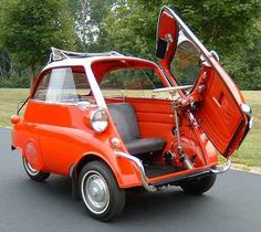 I would to drive one of these.  The 1955 BMW Isetta wsa built to help BMW  out of a difficult commercial phase and was sold to members of its workforce.  Several versions of the 'bubble car' were built until production ceased in 1962. Kinda looks like a VW Beetle and a Fiat.