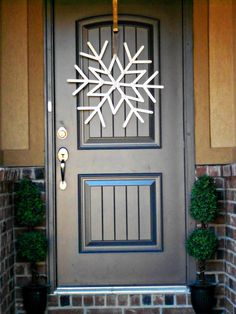 Snowflake Wreath (in red, too - so it shows up?  or...with red behind it so it shows up on white doors...)