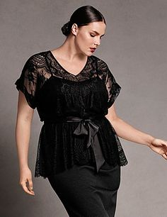 Short sleeve V-neck top with soft peplum styling and satin sash. Pieced lace pattern. Buttoned keyhole back. Attached cami for layering. lanebryant.com