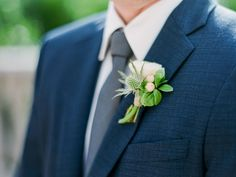 This groom's boutonniere featured a white spray rose, blue thistle and blush coffee bean for a delicate textured touch. | Bob Gail Events #groomsboutonniere